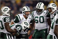 "The Jets have improved from 4-12 in 2007 to 8-3 and atop the AFC East under new QB Brett Favre, who's still not satisfied. ""Believe me,"" Favre says, ""we can get a lot better."""