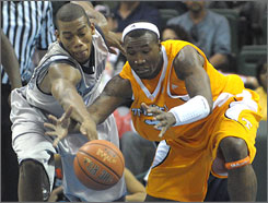 Tennessee and Wayne Chism, right, humbled Georgetown and Greg Monroe on Friday