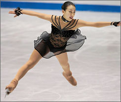 Mao Asada finds plenty of hang time on her way to victory in the free skate portion of the NHK Trophy.