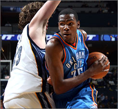 The Thunder's Kevin Durant drives on Grizzlies center Marc Gasol during the second half. Durant scored 30 points as Oklahoma City snapped a 14-game losing streak and won for the first under interim head coach Scott Brooks (1-4).