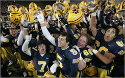 Cleveland St. Ignatius teammates celebrate after beating Cincinnati Elder 28-20 in their Division I high school football state championship game in Canton, Ohio.
