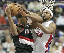 Portland's LaMarcus Aldridge draws a foul from Detroit's Rasheed Wallace in second half of the Trail Blazers' road victory.