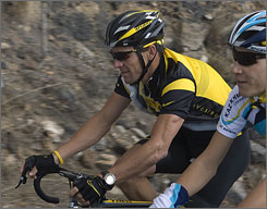 Lance Armstrong participates in a training ride Monday at the Astana team's preseason camp in Tenerife, Spain. He announced he would ride in the Tour de France this year despite his concerns about safety at the race.