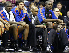 Stephon Marbury takes his place on the Knicks bench in street clothes amidst teammates (from left) Zach Randolph, Danilo Gallinari, Jerome James and Malik Rose.
