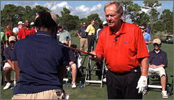 Jack Nicklaus gives pointers to First Tee golfer Sunita Spencer at The Bear's Club in Jupiter, Fla.