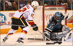 "Calgary's Jarome Iginla, left, has a fearsome presence around the goal, but just don't call him a ""netfront"" player."