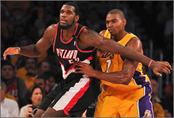 Greg Oden, seen backing in on the Lakers' Andrew Bynum in the season opener, has six double-doubles in 14 games this year.