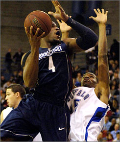Jeff Adrien and second-ranked Connecticut escaped Brian Addison and Buffalo with a 68-64 win.