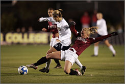 Melissa Henderson, left, and Notre Dame shut out Allison Falk and Stanford to reach the title game in the NCAA Women's College Cup.