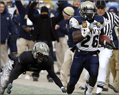 Army defender Mario Hill can't catch Navy running back Shun White, who went all the way for a 65-yard touchdown in the first quarter.