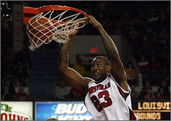 Louisville Cardinals forward Terrence Jennings scores on a slam dunk against the Ohio Bobcats at Freedom Hall in Louisville. Jennings scored six points as the No. 11 Cardinals routed Ohio 91-56.