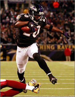 Ravens safety  Ed Reed returns a fumble for a touchdown against the Redskins.