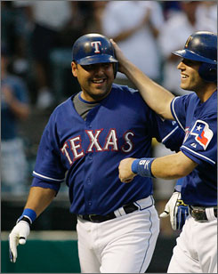 Gerald Laird, left with teammate Ian Kinsler, hit .276 with six homers and 41 RBI last season in 95 games with the Texas Rangers. However, he did set a career high with 24 doubles.
