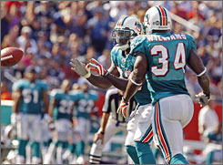 "Dolphins defensive end Vinnie Holliday said Miami defenders were skeptical before the team rolled out the Wildcat offense sparked around running back Ronnie Brown, above. ""The defense was laughing, saying, 'That's not going to work,' "" Holliday says."