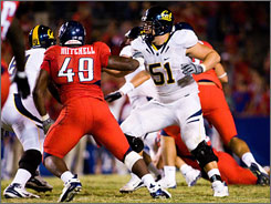 Cal All-America center Alex Mack (51) won the Draddy Trophy, which recognizes academic success, football performance and community leadership. The magna cum laude graduate gets a $25,000 postgraduate scholarship.