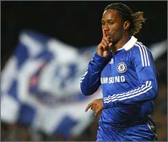 Chelsea's Didier Drogba silences rival fans after his game winner against Cluj.