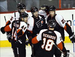 Philadelphia Flyers' Simon Gagne, center, celebrates his game-winning goal in the third period of the Flyers' 4-3 victory against the New York Islanders on Tuesday night in Philadelphia.