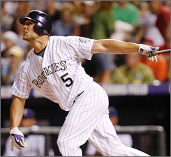 "Matt Holliday hit .321 with 25 homers for the Rockies in 2008 playing in hitter-friendly Coors Field. A's general manager Billy Beane calls him a ""premium MVP-caliber player."""