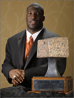 Texas defensive end Brian Orakpo poses with the Rotary Lombardi Award Wednesday in Houston. The award is given to the nation's top college lineman or linebacker. Orakpo is the third Texas player to win the award, and the first since 1984.