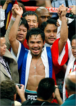 Manny Pacquiao had much to celebrate after a win Saturday against Oscar De La Hoya and a big payday. The match had 1.25 million pay-per-views for $70 million in revenue  the most successful show of 2008.