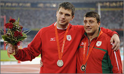 Belarusian hammer throwers Vadim Devyatovskiy, left, and Ivan Tsikhan had their Olympic medals stripped after they tested positive for elevated testosterone levels at the Beijing Games.