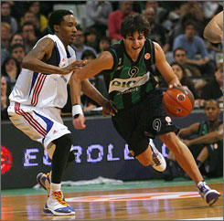 Ricky Rubio (right) drives against Brandon Jennings during Thursday's EuroLeague basketball Group C match.