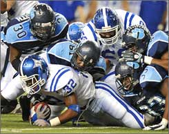 Peachtree Ridge's Ronnie Smith (32) is tackled by Camden County defenders Saturday.