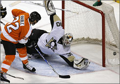 Philadelphia's Mike Knuble watches his first of two goals get past Pittsburgh goalie Dany Sabourin in the Flyers' 6-3 win over the Penguins on Saturday.