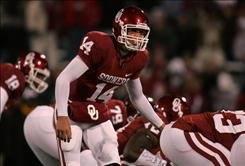With quarterback Sam Bradford running Oklahoma's no-huddle offense, the Sooners became the highest-scoring team in the modern era (702 points).