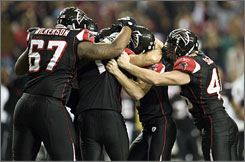 Falcons players celebrate the game-winning field goal that improved their record to 9-5.
