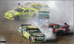Travis Kvapil (28), Ken Schrader (96), Paul Menard (15), Robby Gordon (7) and Bill Elliot (21) wind up headed in the wrong direction in a stack-up at Phoenix International Raceway.