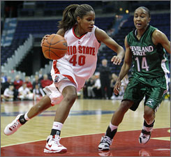 Ohio State's Brittany Johnson, left, drives to the basket against Cleveland State's Shawnita Garland during the second half of their game in Columbus, Ohio. Johnson scored 12 points as Ohio State beat Cleveland State 68-54.