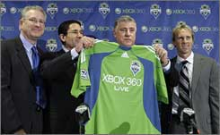 From left: Tod Leiweke, CEO of Paul Allen's Vulcan Sports and Entertainment; Sounders GM Adrian Hanauer; newly appointed Sounders coach Sigi Schmid; and Sounders technical director Chris Henderson.