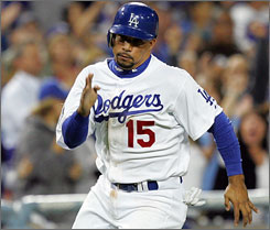 Rafael Furcal will remain with the Los Angeles Dodgers after reaching an agreement late Wednesday.