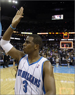 New Orleans Hornets guard Chris Paul waves to the fans after his team defeated the San Antonio Spurs 90-83 Wednesday in New Orleans. Paul had 19 points and three steals, his 106th consecutive game with at least one steal.