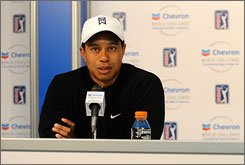 Tiger Woods speaks during a news conference before the Chevron World Challenge, a tournament he will host in Thousand Oaks, Calif. Woods said Wednesday that he is on schedule to return for the Masters and that his injured left knee will be stronger than ever.