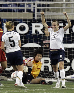 The USA's Heather O'Reilly, right, celebrates her first-half goal past China goalie Zhang Yanru while teammate Lindsay Tarpley looks on during the first half of their soccer exhibition game at Ford Field in Detroit. The USA won 1-0.