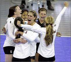 Stanford women's volleyball players celebrate after rallying to defeat Texas in a semifinal of the NCAA women's volleyball tournament in Omaha. The Cardinal won 3-2 and became the first school to overcome a 2-0 deficit to win a semifinal in the tournament's 27-year history.