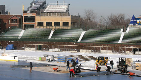 Workers construct the outdoor ice rink at Wrigley Field prior to a media briefing for the NHL Winter Classic on Thursday. The Winter Classic will feature the Chicago Blackhawks and Detroit Red Wings on New Years Day.