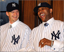 Free-agent prizes A.J. Burnett, left, and CC Sabathia share a lighter moment during their introductory press conference on Thursday at Yankee Stadium.
