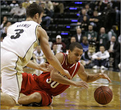 Davidson's Stephen Curry is hounded by Purdue's Chris Kramer during their battle in Indianapolis. The Boilermakers held Curry to just 13 points as they cruised to a 76-58 victory.