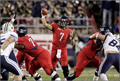 Arizona quarterback Willie Tuitama threw for 325 yards and two touchdowns to help the Wildcats win their first bowl game since 1998.