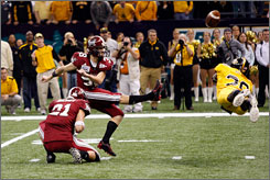Southern Mississippi's Michael McGee blocks the field goal attempt by Troy's Sam Flusman to seal the New Orleans Bowl victory for the Golden Eagles.