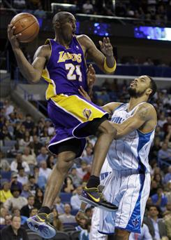 New Orleans Hornets center Tyson Chandler guards Los Angeles Lakers guard Kobe Bryant, who scored 26 points as the Lakers beat the Hornets 100-87 in New Orleans.