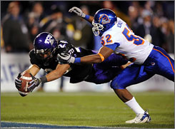 TCU's Joseph Turner dives into the end zone to score the game-winning touchdown for the Horned Frogs as the Mountain West Conference team handed Boise State its first and only loss of the season.
