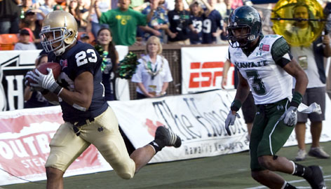 Notre Dame wide receiver Golden Tate, left, breaks away from Hawaii defensive back Jameel Dowling and runs into the end zone for a touchdown during the third quarter of the Hawaii Bowl in Honolulu. Tate had six catches for 177 yards and three touchdowns.