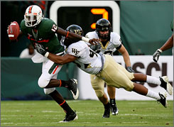 Miami quarterback Jacory Harris, tackled by Wake Forest's Stanley Arnoux in October, has started 31 games dating to high school and prevailed in every one. He'll start in place of Robert Marve vs. California in Saturday's Emerald Bowl.