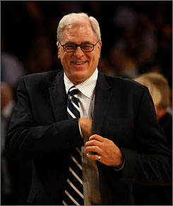 Los Angeles Lakers coach Phil Jackson became the sixth coach in NBA history with 1,000th career victories. Jackson, 63, has a career record of 1,000-423 in 17-plus seasons as coach of the Chicago Bulls and Lakers.