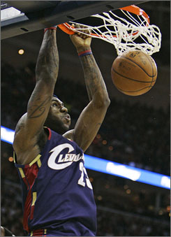 Cleveland Cavaliers forward LeBron James dunks against the Washington Wizards in the first quarter of their game in Cleveland. James had 18 points, five rebounds and six assists as Cleveland rallied to win 93-89.
