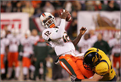 Miami Hurricanes quarterback Jacory Harris is sacked by California Golden Bears linebacker Zack Follett during the first quarter of their game at AT&T Park in San Francisco. Follett forced a fumble by Harris late in the fourth quarter which the Bears converted into the winning touchdown.